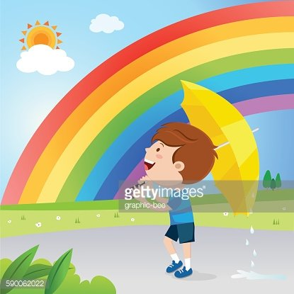 Boy with red umbrella under the rainbow