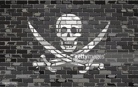 Pirate flag on a brick wall