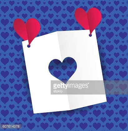 A paper stencil heart and two red paper hearts