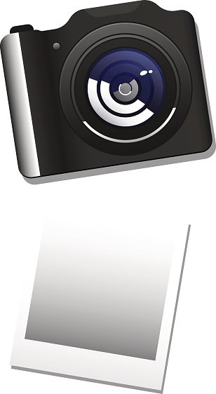 photo camera and paper on white background