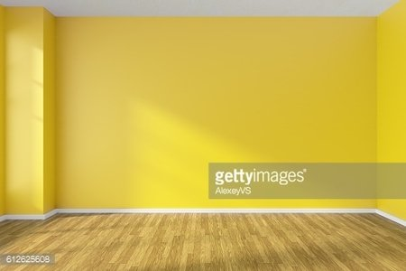 Empty room with yellow walls and wooden parquet floor