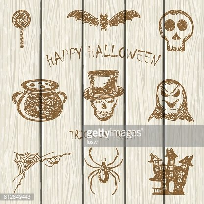 Sketches Halloween icons on white wooden background