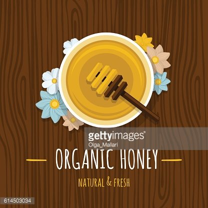 Honey pot with a spoon on the wood table.Top view.