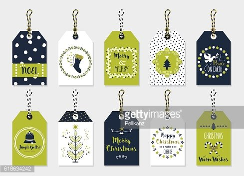 Green and navy blue Christmas gift tags set on gray