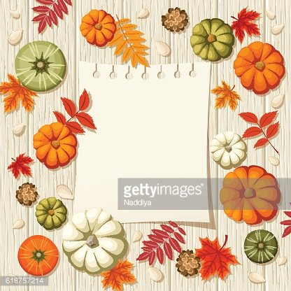 Pumpkins, autumn leaves and notepad sheet on a wooden background.