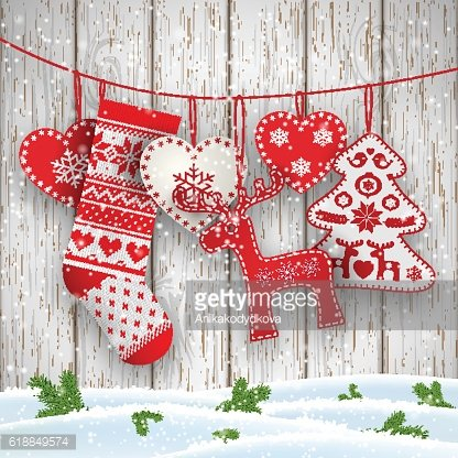 Christmas folklore decorations hanging in front of white wooden wall