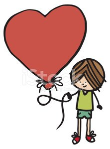 Boy with large heart shaped balloon