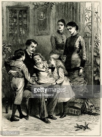 Group of Victorian children being told a Christmas story