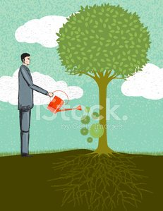 Businessman Watering a Tree. Business Growth Concept