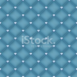 Seamless green velvet quilted background with silver heart shape