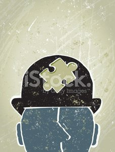 Businessman with Jigsaw Puzzle Piece on in his Hat