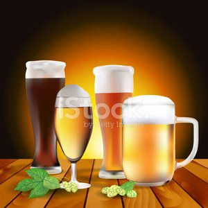 Still life with beers and hops on wooden table