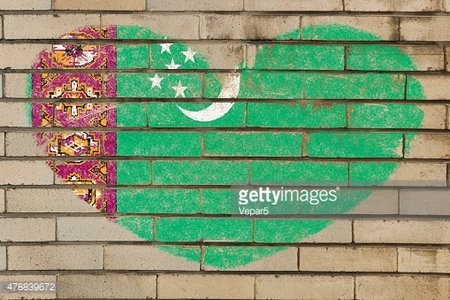 heart shape flag of turkmenistan on brick wall