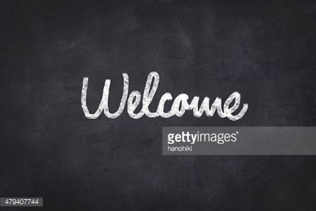 welcome handwritten - black chalkboard with white text