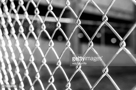 Abstract black and white background of metal wire fence