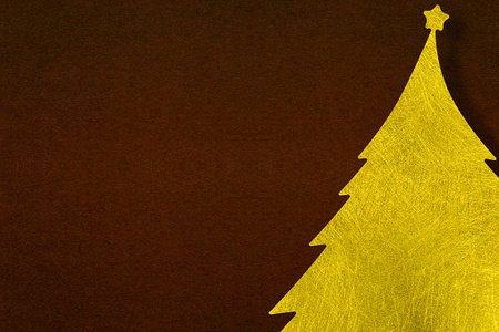 Gold fiber Christmas tree with paper dark brown background