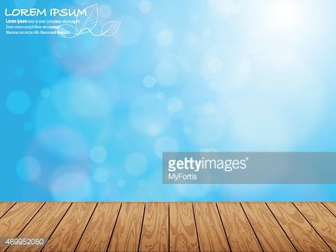 Wooden pieces and natural blue blur background