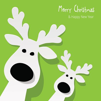Two white Reindeer on a green background.