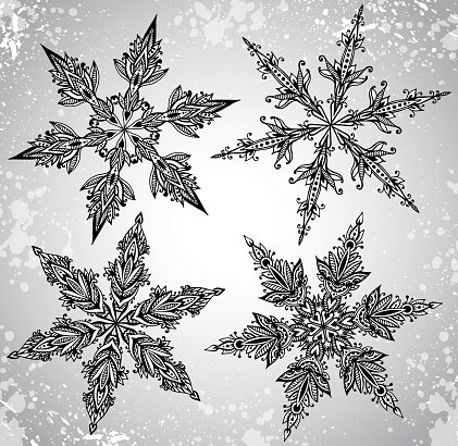 SEt of four beautiful hand drawn ornamental doodle snowflakes