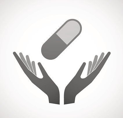 Two hands offering a pill