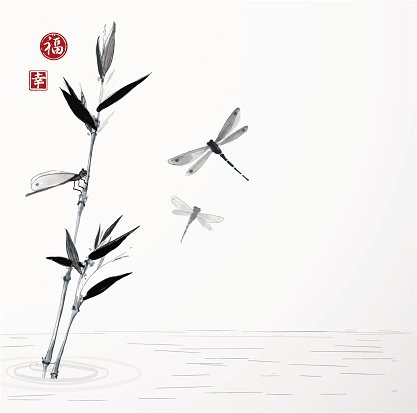 Bamboo branch and three dragonflies