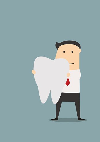 Businessman holding a large white tooth