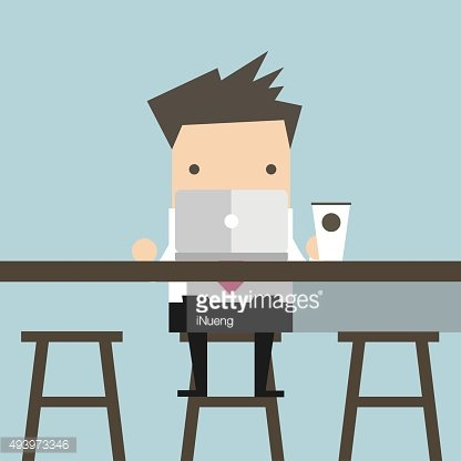 Businessman working on laptop at coffee bar