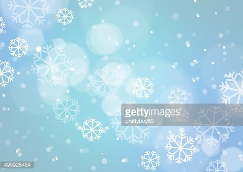 Abstract Bokeh Light with Snowflakes on Blue Background