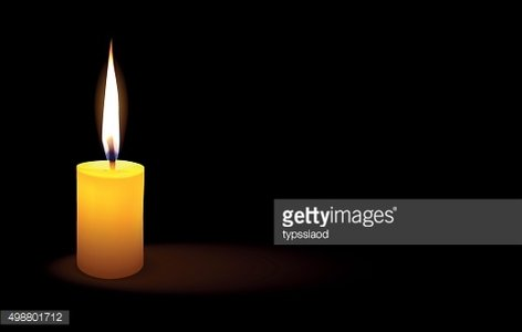 Yellow candle lit a light in the darkness.