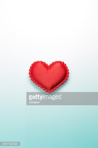 Single red heart on gradated background