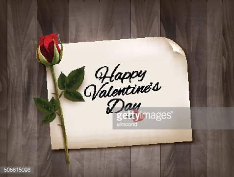 Happy Valentine's Day background with note on wooden wall an