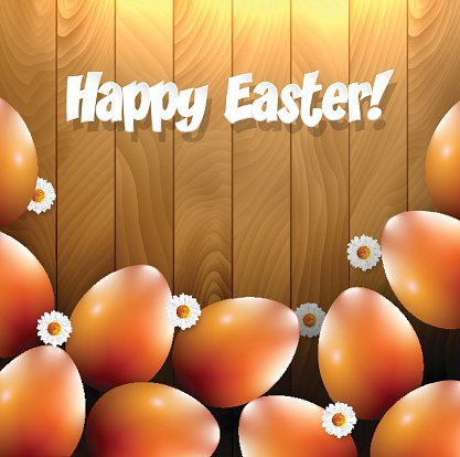 Easter eggs and small flowers on a wooden background