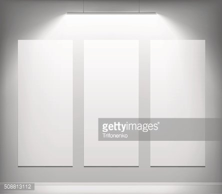 Three white canvas hanging on the wall.