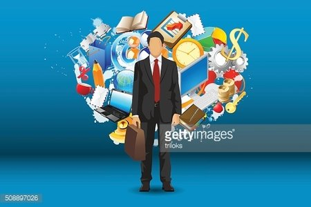 Businessman standing with objects all around
