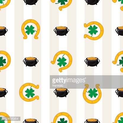 Green shamrock leaves and horseshoes . St. Patrick's day background