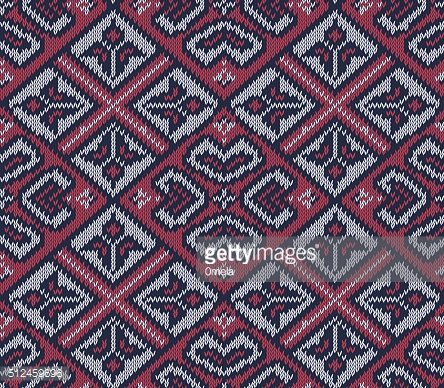 Knitted background in Fair Isle style in three colors. Seamless