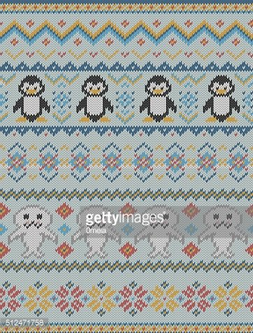 Knitted bright seamless winter pattern with stylized penguins and seals