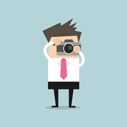 Businessman takes a picture with camera