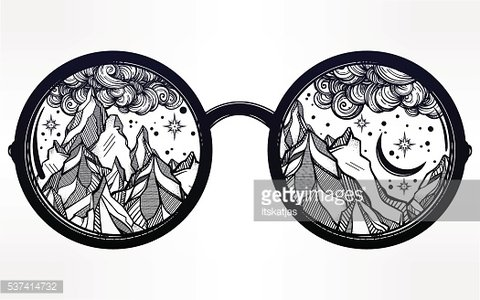 Round glasses with mountains in the reflection.
