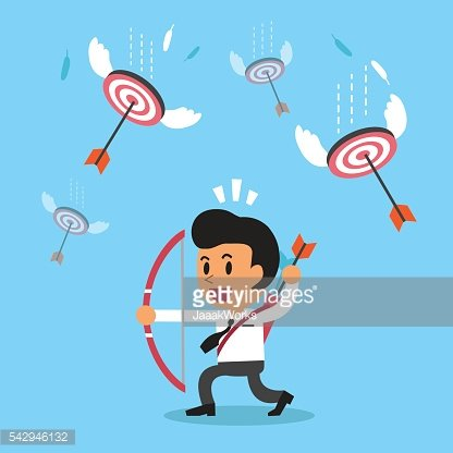 Businessman shooting targets with a bow and arrows