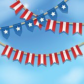 Bunting decoration in colors of USA flag. Blue sky