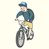 School boy riding bmx bycicle