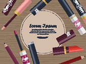 Collection of lip glosses, lipsticks and lip pencils on the