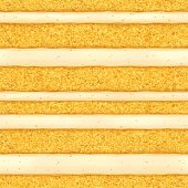 Sponge cake background. Colorful seamless texture.