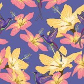Seamless pattern with hibiscus flowers and hummingbird on blue b