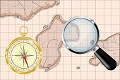 Old map, golden compass and magnifying glass