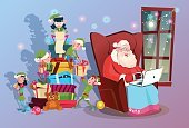 Santa Claus Using Laptop Green Elf Helper Group With Present