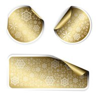 Golden Christmas labels and stickers with snowflakes