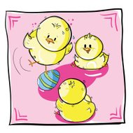 Chicks playing with Easter egg