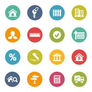 Colorful circular real estate icons on white